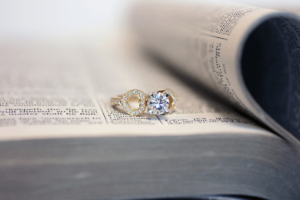 Unique and affordable engagement ring hearts hold diamond in place